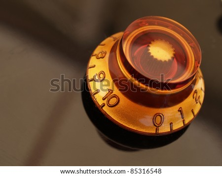 vintage jazz guitar tone knob detail - stock photo