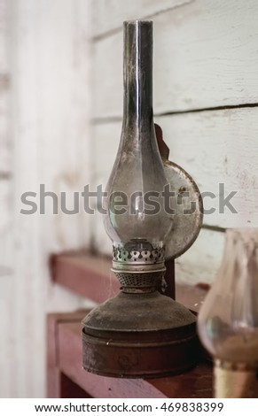 Vintage kerosene lamp and candle holder, vertical, angle view