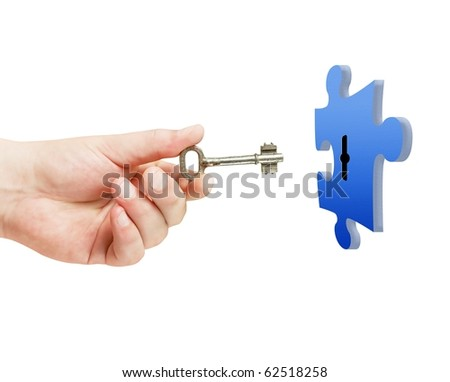 vintage key in hand with puzzle isolated - stock photo
