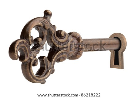 Vintage key in keyhole, isolated on the white background, clipping path included. - stock photo