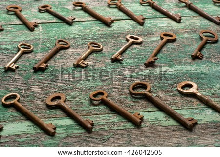 Vintage keys on wooden table top view. - stock photo