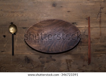 Vintage kitchen silverware  and utensils on a wooden background