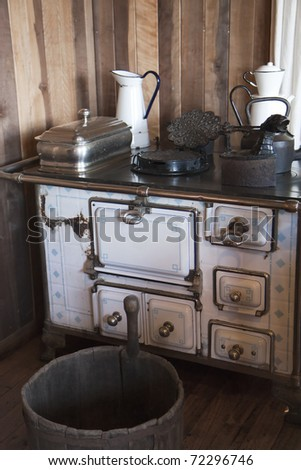 Vintage kitchen - stove and pots - stock photo