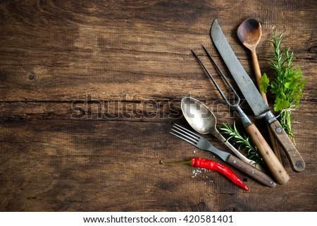 vintage kitchen utensils on wooden table - stock photo