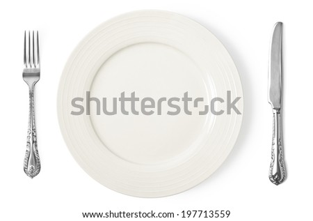 Vintage knife, fork and plate on white background - stock photo