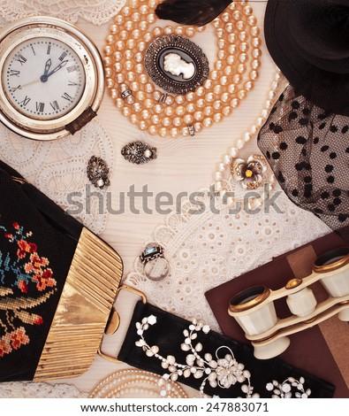 Vintage ladies things. Jewelry, handbags and opera glasses - stock photo
