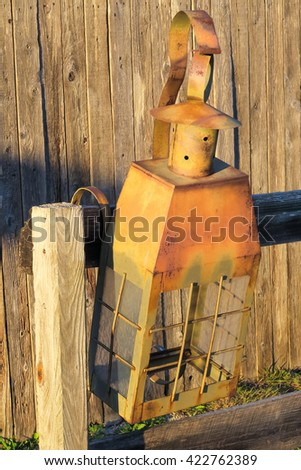 vintage lamp hung on the hitching post - stock photo