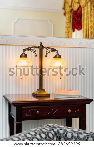 Vintage lamp on the wooden table