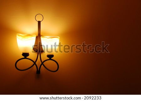 vintage lamp on wall - stock photo