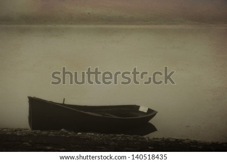 vintage landscape with boat and calm lake in fogy morning - stock photo