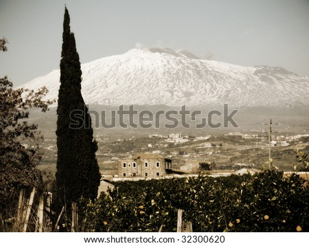 vintage landscape with cypress and old farmhouse in background volcano Etna - stock photo