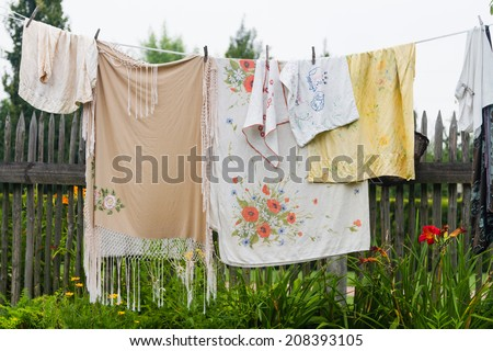 Vintage laundry hanging out to dry outdoors in summer on a heritage park - stock photo