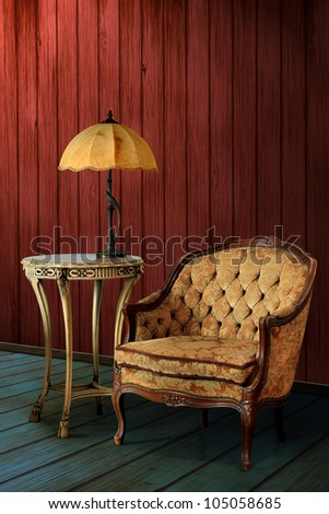 Vintage leather armchair and a retro lamp with wood wall background - stock photo