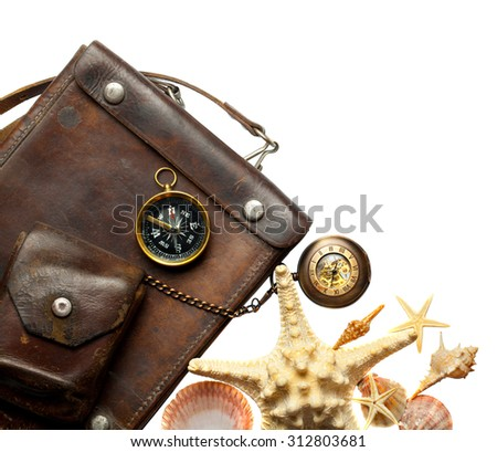 Vintage leather bag with a compass and a pocket clock isolation on a white background - stock photo