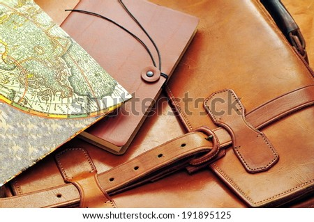 Vintage leather briefcase with old map and note  - stock photo