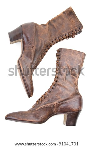 Vintage leather lady's boots isolated on white - stock photo