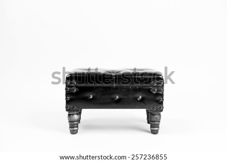 Vintage leather ottoman footrest. Front view. Black and white - stock photo