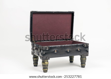 Vintage leather ottoman footrest with storage, open top. Angled view - stock photo