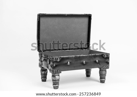 Vintage leather ottoman footrest with storage, open top. Angled view. Black and white - stock photo