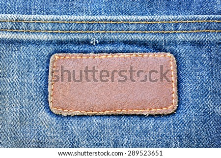 Vintage Leather Pad on Pale Blue Jeans Trousers Surface Pattern Texture Background