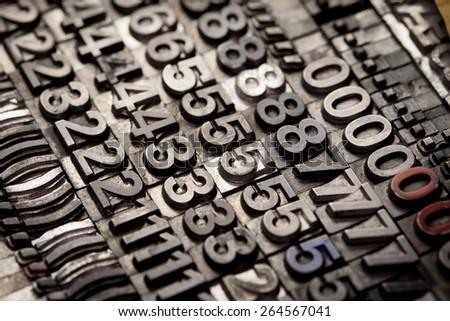 vintage letterpress alphabet and number background - stock photo
