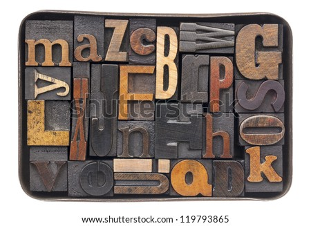 vintage letterpress wood type blocks with ink patina - all 26 letters of alphabet in an old metal box - stock photo