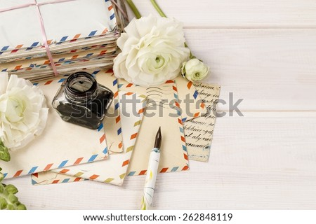 Vintage letters, ink and pen. White persian buttercup flowers (ranunculus) on wooden background, copy space - stock photo