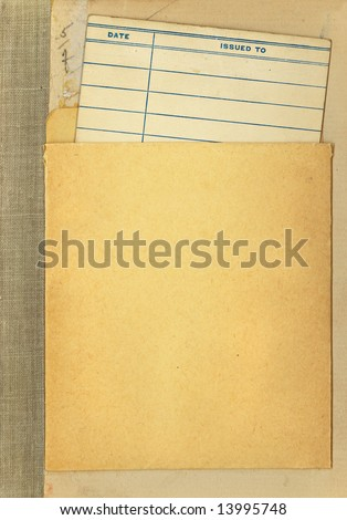 Vintage Library Book due date card in it's pocket atatched to an old book. - stock photo