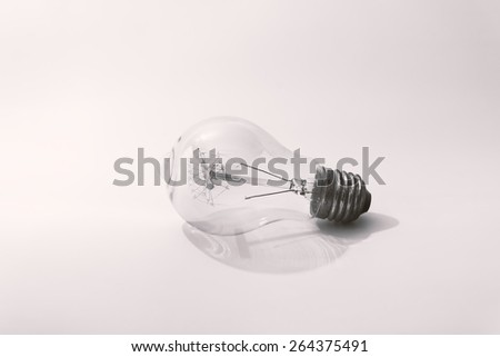 Vintage light bulb.Close up and used vintage filter Black and white style. - stock photo