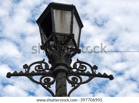 Vintage light post from Spanish colonial times in Havana, Cuba. - stock photo