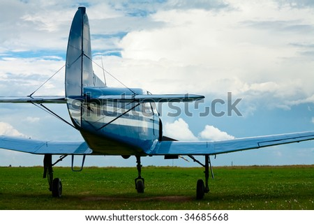 Vintage light sport aircraft in the evening light - stock photo