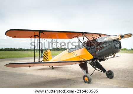"Vintage little plane: The German Bucker 131 ""Jungmann"" ; (Young man) was a training aircraft during World War II. - stock photo"