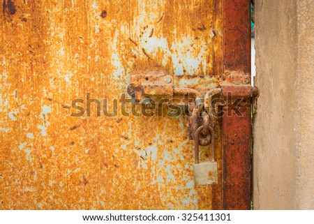 Vintage Lock on Bright Red Door - stock photo