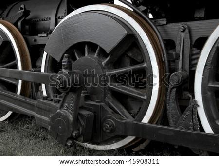 Vintage locomotive wheel closeup - stock photo