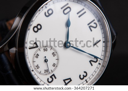 Vintage look marine watches with white dial, and arabic numbers, blued hands, onion crown macro closeup