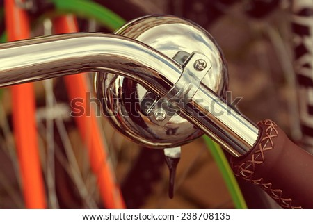 Vintage look of one detail at a bicycle bell attached to the handlebars. - stock photo
