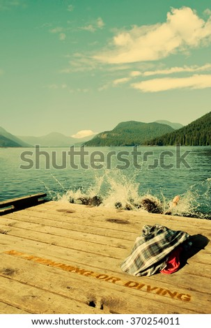 Vintage look of swimmers in a lake. - stock photo