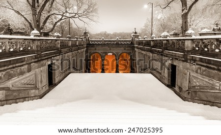 Vintage look of the pedestrian tunnel under Terrace Drive, at the end of the Mall, on a snowy morning, in Central Park, NYC - stock photo