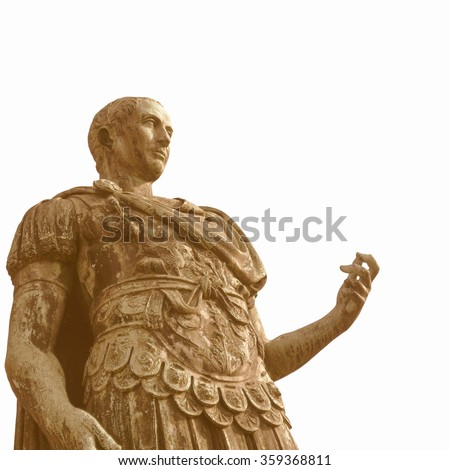 Vintage looking A bronze roman statue of Iulius Caesar in Turin, Italy isolated over white