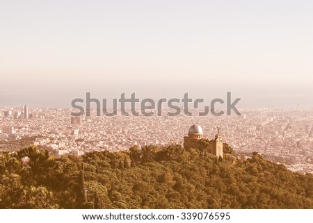 Vintage looking Aerial view of Barcelona from the hills surrounding the city