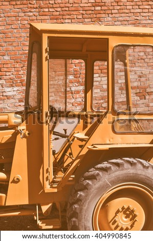 Vintage looking An old tractor vehicle machinery used in agriculture or construction