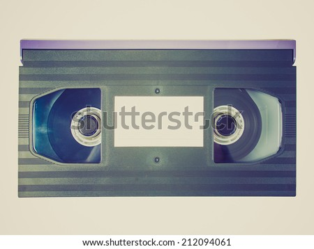 Vintage looking Betamax video tape cassette isolated over white background - stock photo
