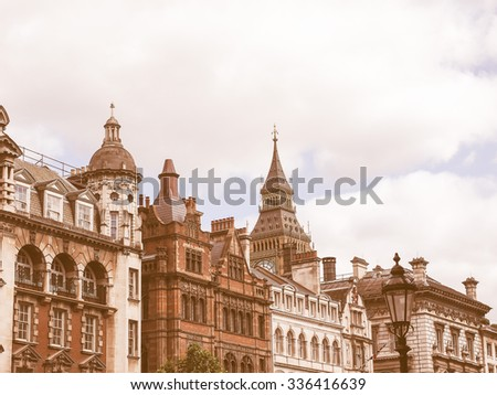 Vintage looking Big Ben at the Houses of Parliament aka Westminster Palace seen from Parliament Street in London, UK - stock photo