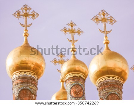Vintage looking Cathedral of the Dormition Russian Orthodox church dedicated to the Dormition of the Theotokos in Moscow Russia - stock photo