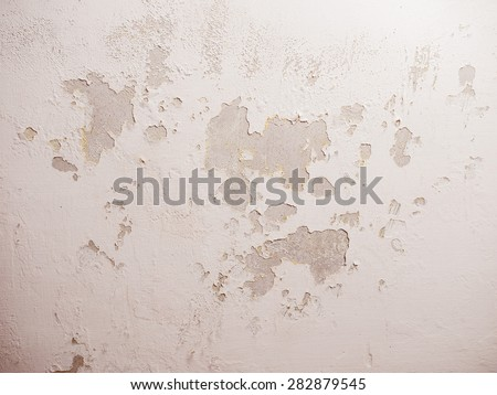 Vintage looking Damage caused by damp and moisture on a wall - stock photo