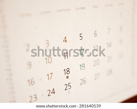 Vintage looking Detail of a calendar page with dates - stock photo