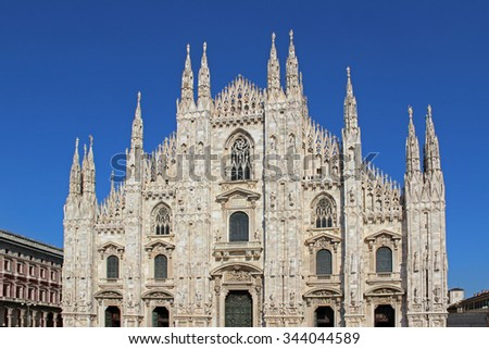 Vintage looking Duomo di Milano meaning Milan Cathedral in Italy, with blue sky - stock photo