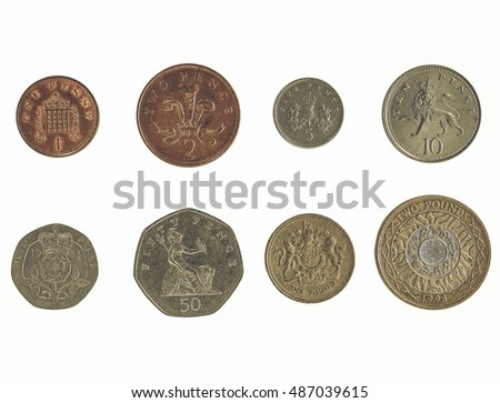 Vintage looking Full series of Pound and Pence coins currency of the United Kingdom isolated over white