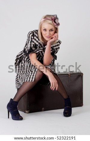 vintage-looking girl with baggage
