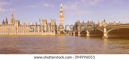 Vintage looking High resolution panoramic view of the Houses of Parliament Big Ben and Westminster Bridge seen from river Thames in London, UK - stock photo